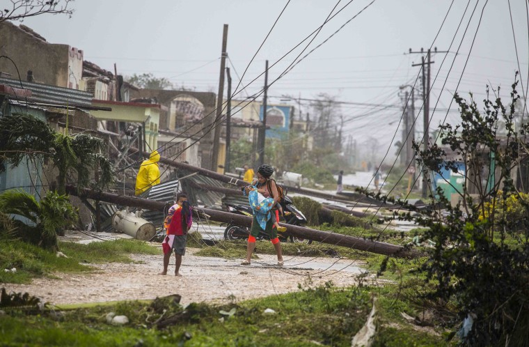 Image: Residents walk near downed power lines felled by Hurricane Irma, in Caibarien, Cuba