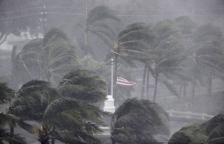 Image: An American flag is torn as Hurricane Irma passes through Naples on Sept. 10.