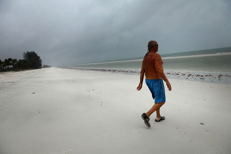 Image: Larry Mawer goes for a swim on a deserted beach in Bonita Springs as Hurricane Irma arrives into southwest Florida on Sept.10.