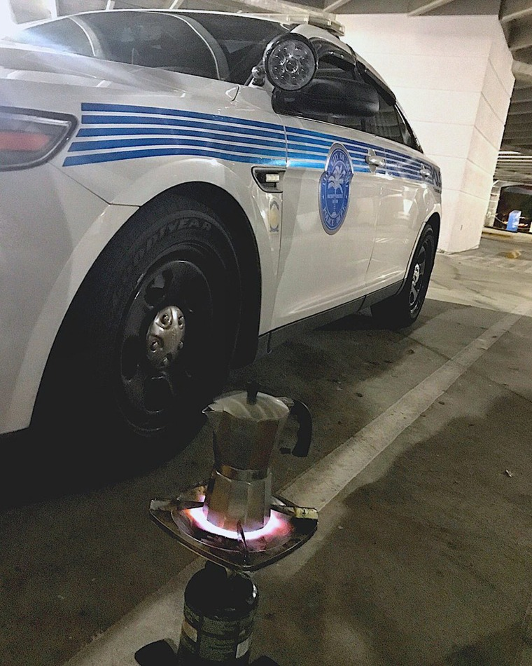 "Image: The Miami Police Department places a Cuban ""cafetera"" on a makeshift burner in Miami as officers prepare for the arrival of the hurricane on Sept. 9."