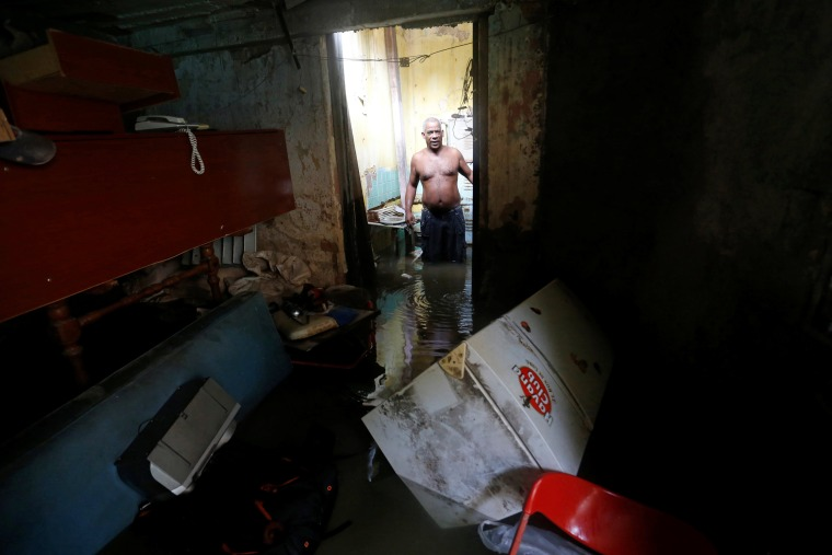 Image: A man stands in his flooded home after the passing of Hurricane Irma in Havana