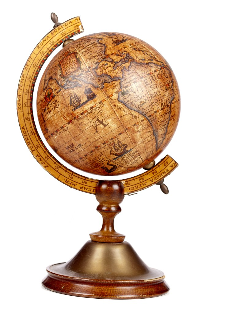 An old brown vintage globe on a small stand