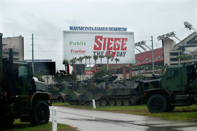 Image: Military equipment sits in the parking lot of Tampa's Raymond James stadium ahead of Hurricane Irma on Sept. 10.