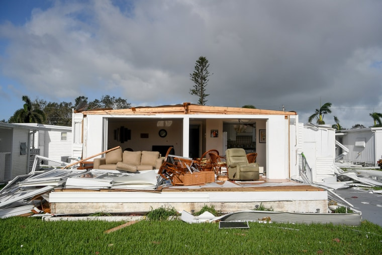 Image: A trailer home with had its front wall ripped off by hurricane winds near Naples, Sept. 11.