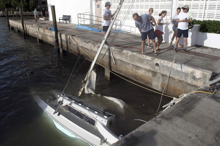 Image: Partially submerged boats sit in a marina in downtown Miami on Sept. 11.