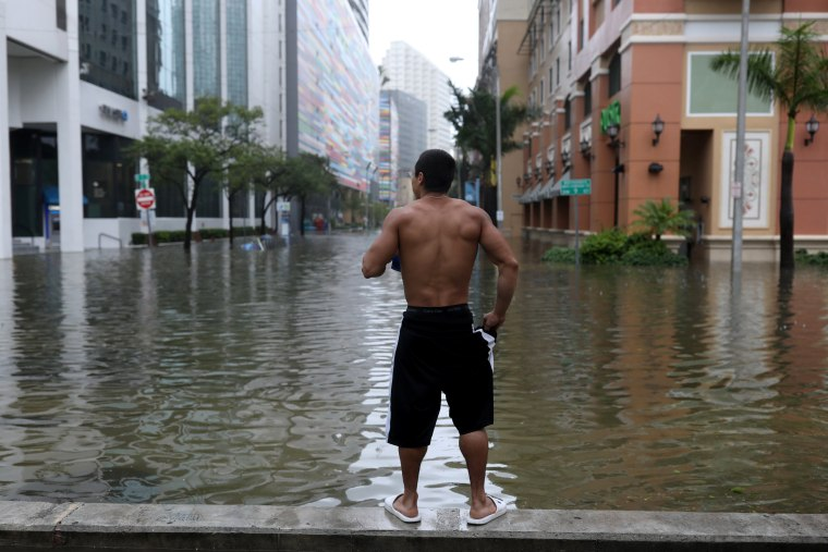 Image: Local resident Vishnu Obregon surveys the flooding in the Brickell neighborhood of Miami on Sept. 10, 2017.