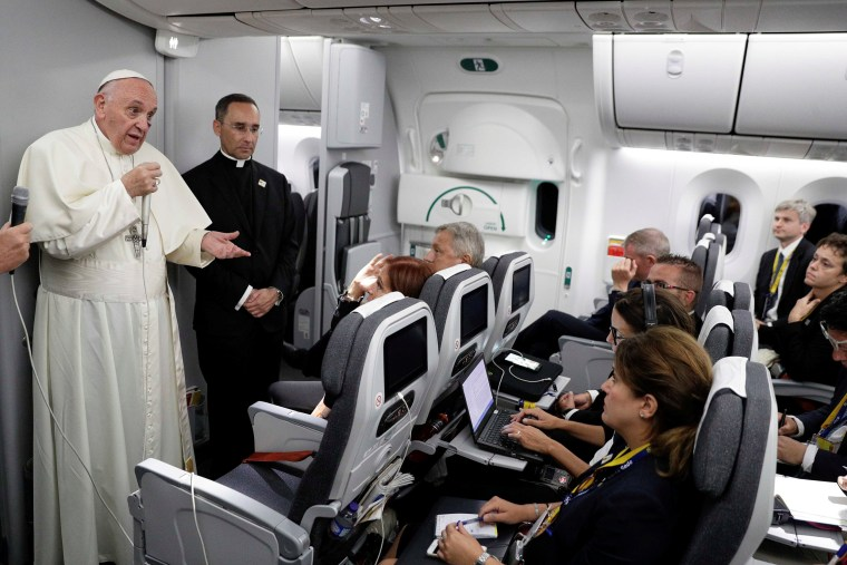 Image: Pope Francis talks to journalists during a press conference aboard a plane to Rome at the end of his visit to Colombia