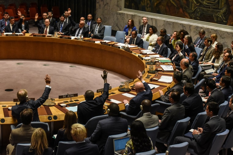 Image: Ambassadors to the UN vote during a United Nations Security Council meeting on North Korea in New York City