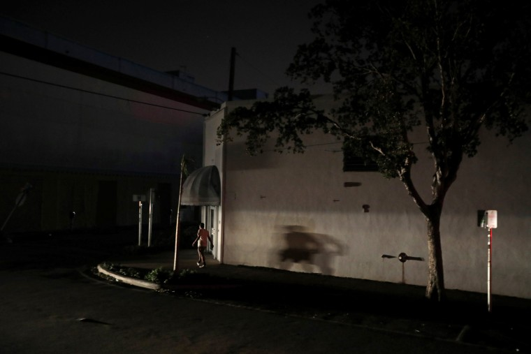 Image: A man walks in the darkness as many areas of Miami still without electricity after Hurricane Irma strikes Florida, in Little Havana, Miami, Florida,