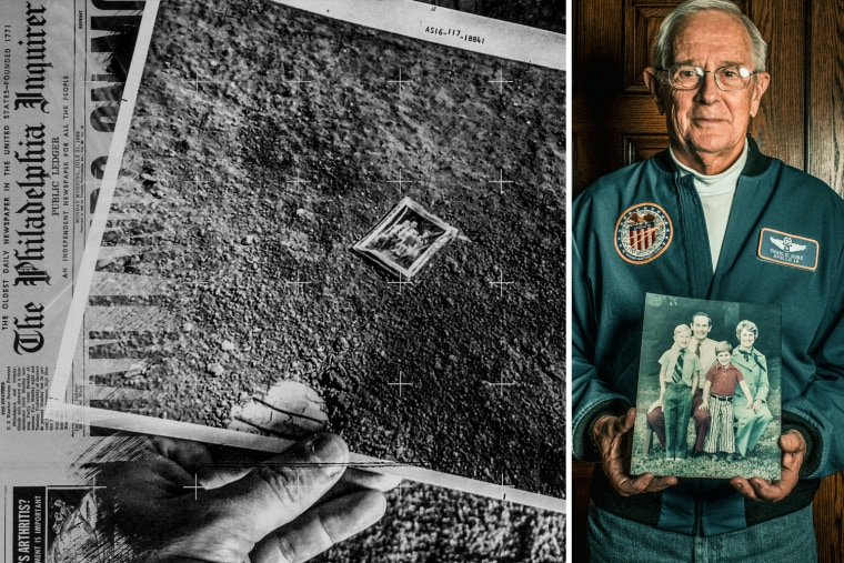Astronaut Charlie Duke holds a copy of the family photo that has been on the moon since he left it there on April 23, 1972.