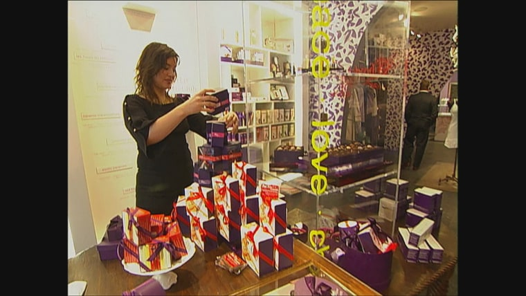 Vosges Haut Chocolat founder, Katrina Markoff, adjusts the display at one of her company's retail locations.