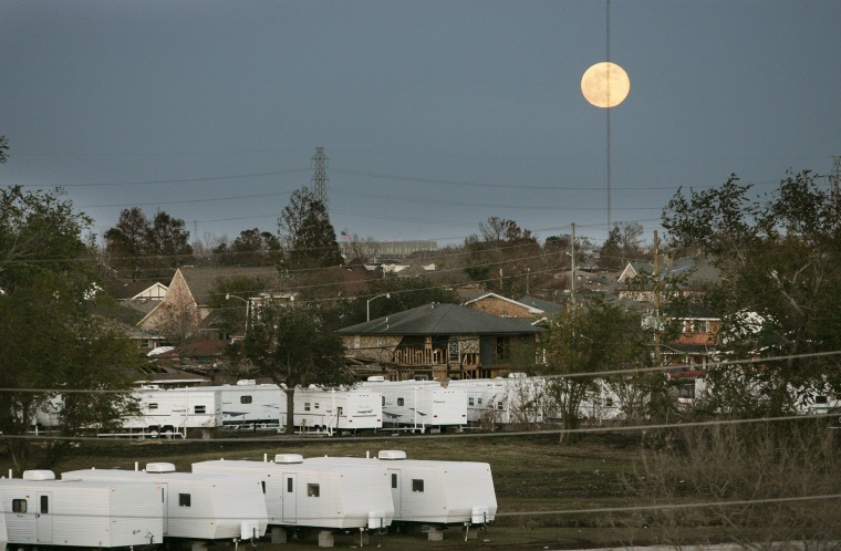 The moon rises over FEMA trailers and damaged homes in St. Bernard Parish, Louisiana on Dec. 15, 2005.