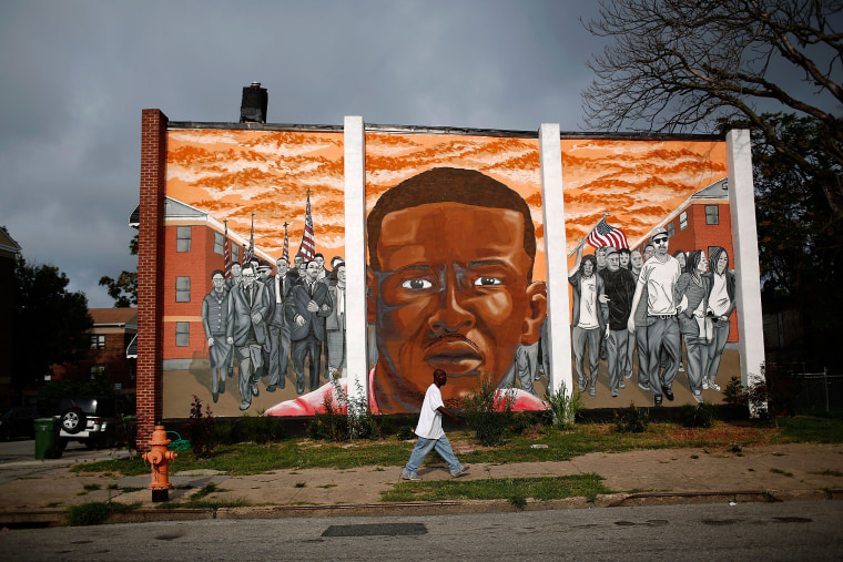 Image: A mural of Freddie Gray near the location where he was arrested
