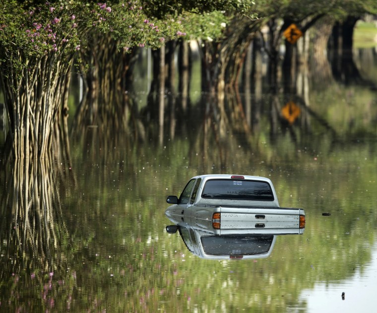 Image: A submerged pickup truck in Katy, Texas