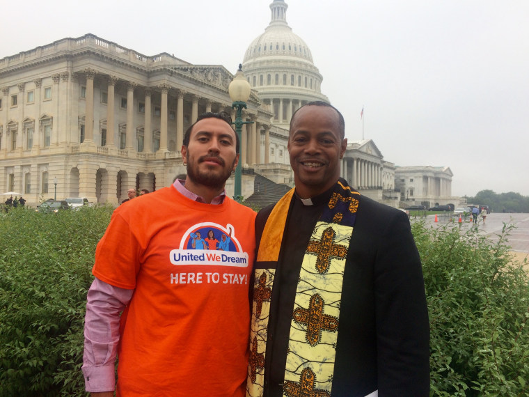 The Rev. Reuben Eckels of Church World Service washed the feet of Irvin Enriquez of Washington State to pressure Congress to address the predicament of DACA recipients. Thw two posed after at the Capitol on Sept. 13, 2017.