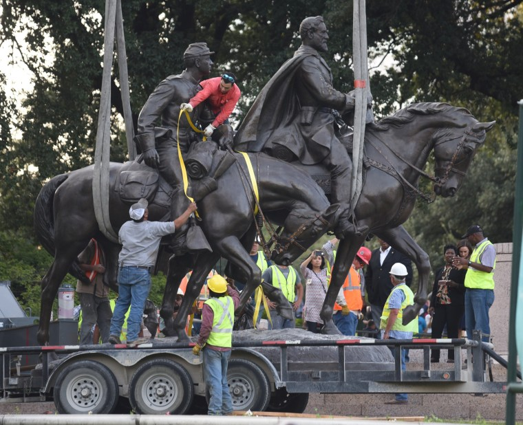 Image: The statue of Robert E. Lee is removed from Lee Park in Dallas