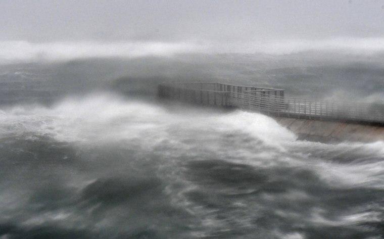 Image: A rough surf surrounds Boynton Beach inlet