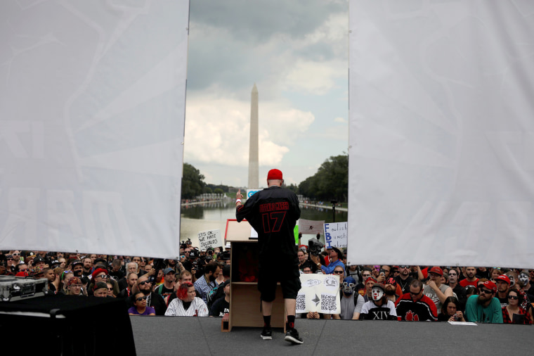 Image: Speaker is seen near the reflecting pool during the Juggalo March in Washington