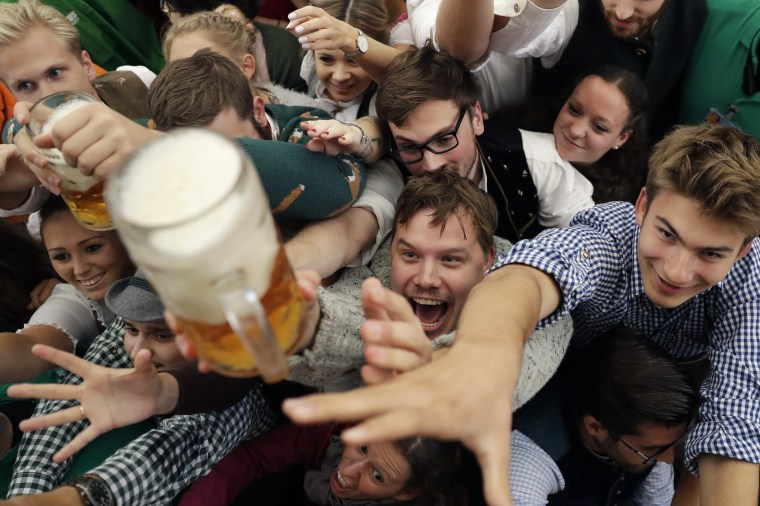 Image: People reach for beer