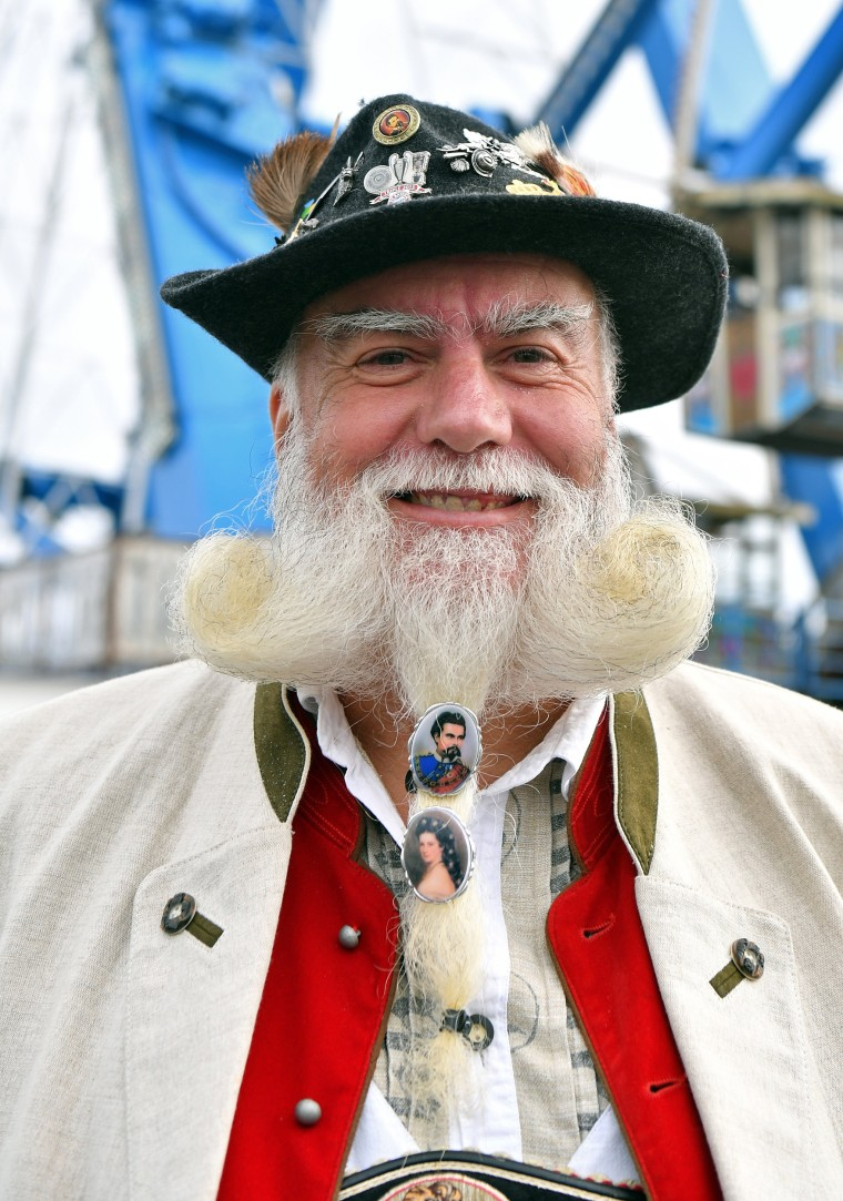 Image: A man dressed in traditional Bavarian clothes attends the first day of the 2017 Oktoberfest beer fest