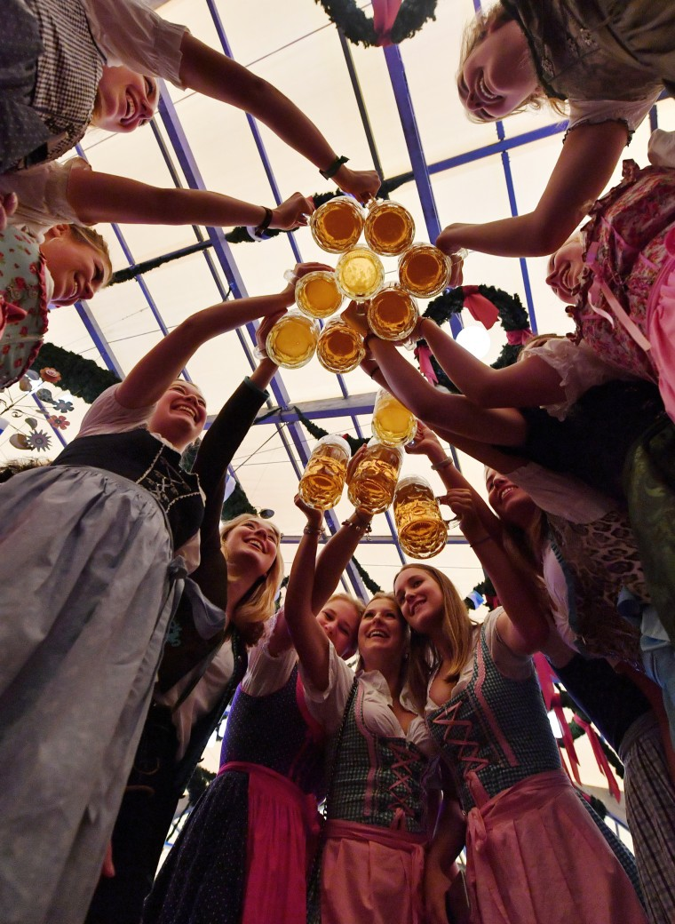 Image: A group of women celebrate the opening of the 2017 Oktoberfest beer festival
