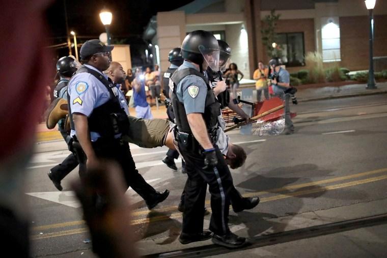 Image: Police arrest a demonstrator.
