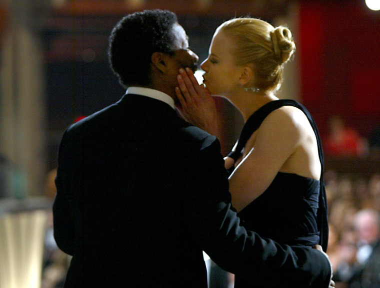"Nicole Kidman won Best Actress for ""The Hours"", kisses presenter Denzel Washington"