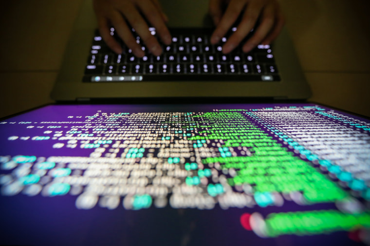 Image: A programmer shows a sample of decrypting source code in Taipei