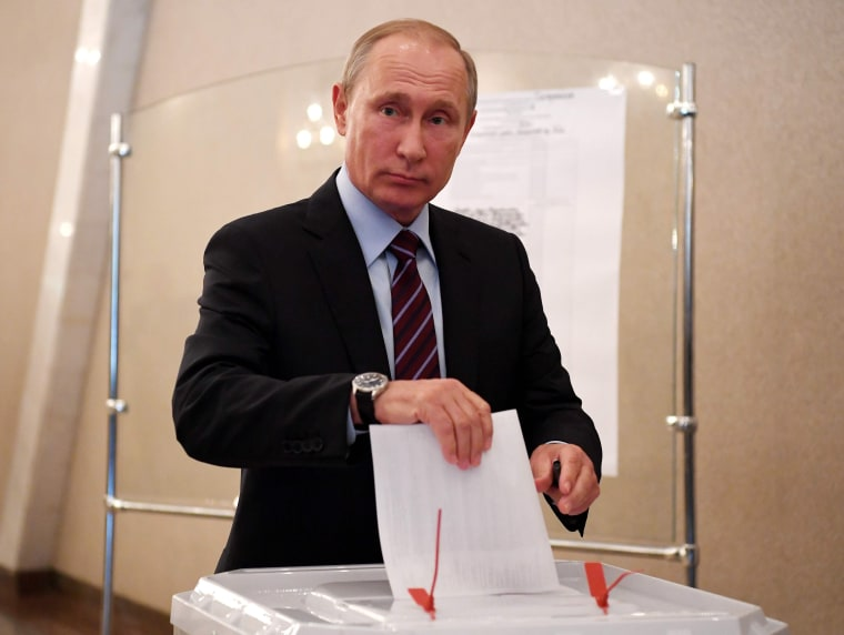 Image: Vladimir Putin votes in a municipal election on Sept. 10, 2017