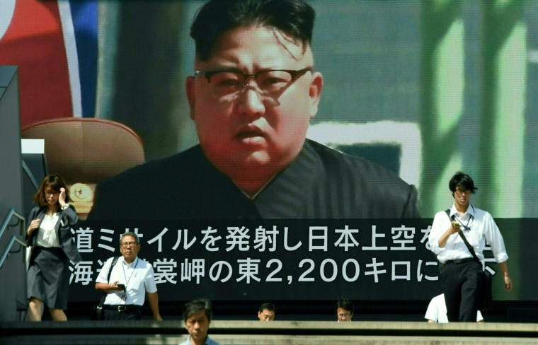 Image: Kim Jong Un's image on a video screen in Tokyo