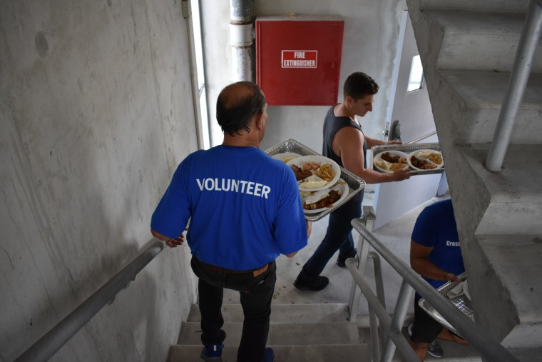 Volunteers deliver food in Miami to Hurricane Irma victims.