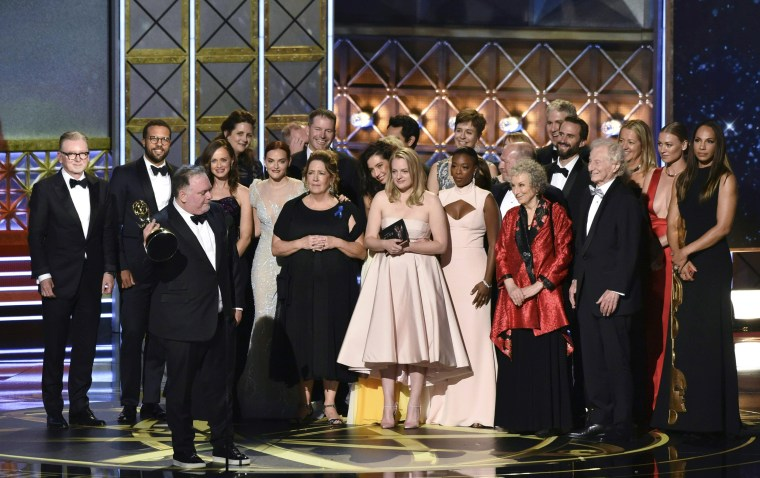 "Image: The cast and crew of ""The Handmaid's Tale\"" accept the award for Outstanding Drama Series"