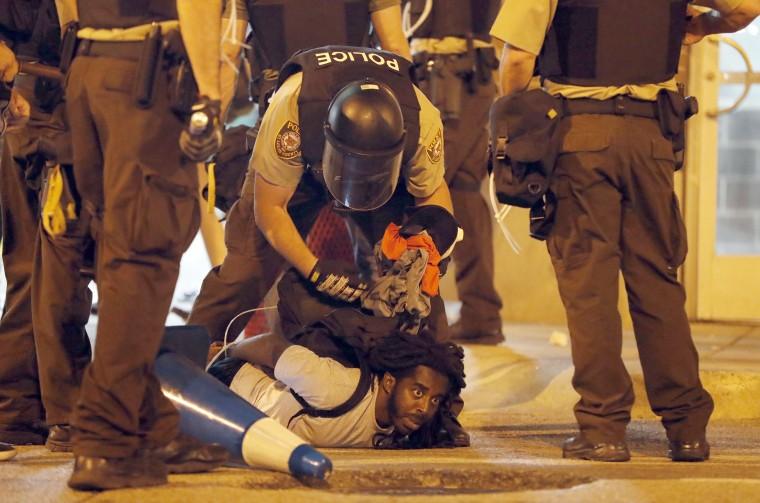 Image: Police make an arrest.