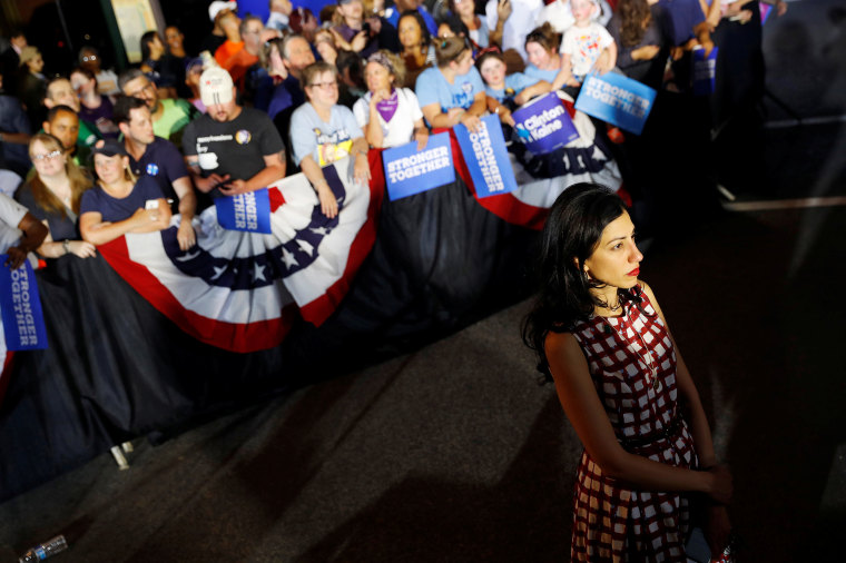 Image: Senior adviser Huma Abedin looks on as then-Democratic presidential candidate Hillary Clinton campaigns with vice presidential candidate Senator Tim Kaine (D-VA) at the Broad Street Market in Harrisburg, Pennsylvania, July 29, 2016.