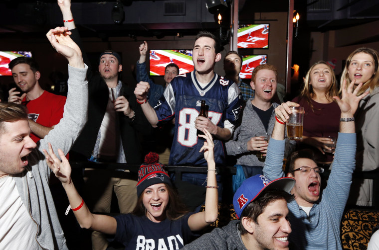 Fans at a Boston bar react while watching the first half of the Super Bowl in 2017.