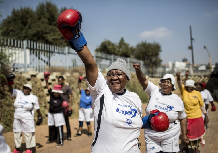"""Image: The """"Boxing Gogos"""" (Grannies) stretch during a session hosted by the A Team Gym in Cosmo City"""