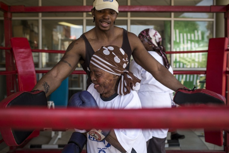 Image: Zodwa Thwala, 74, front, spars with trainer Nqobile Khumalo