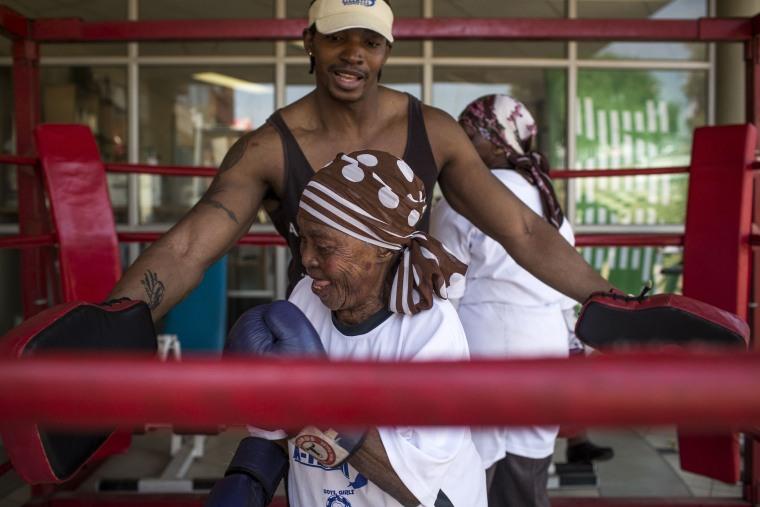 Image: Zodwa Thwala, 74, front, spars with trainer Nqobile Khumalo