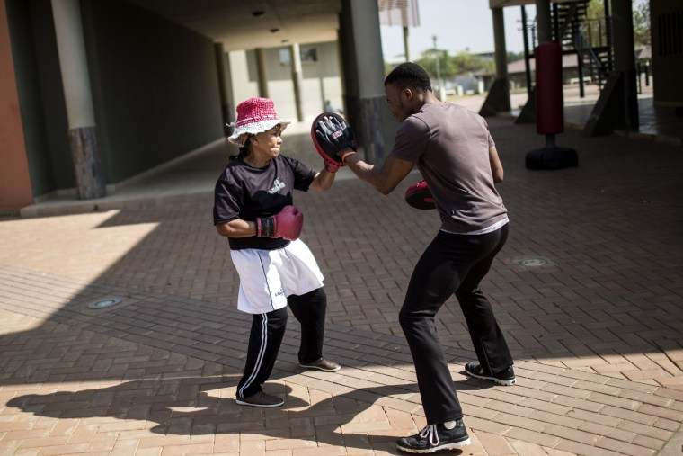 Image: Gladys Ngwenya  spars with a trainer