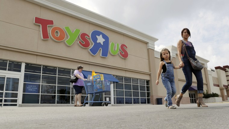 Image: Shoppers leave a Toys R Us store