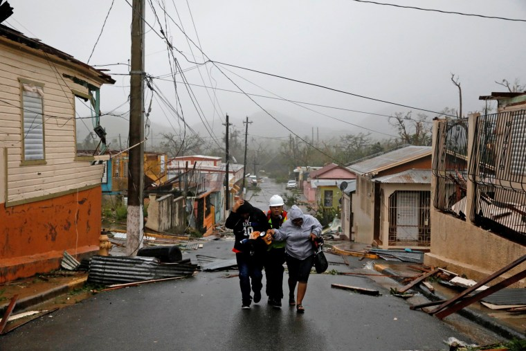 Image: Rescue workers help people after the area was hit by Hurricane Maria in Guayama