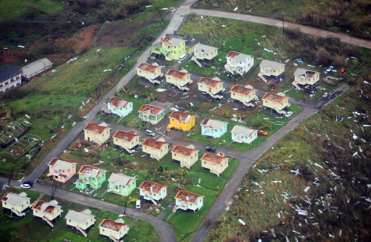 Image: Damaged homes from Hurricane Maria are shown in this aerial photo over the island of Dominica