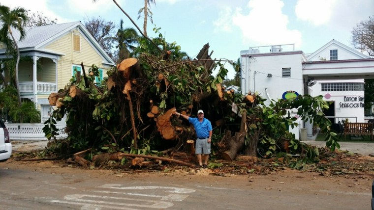 Jim Gilleran next to a downed tree in Key West, Fla.