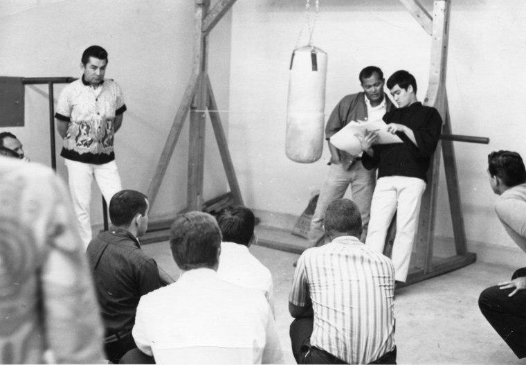 Dan Inosanto and Bruce Lee teach a martial arts lesson.