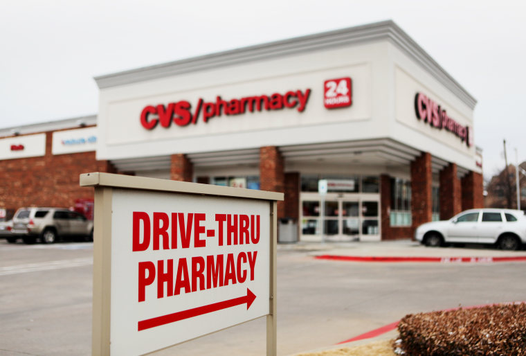 "Image: A ""Drive-Thru Pharmacy"" sign is displayed outside of a CVS Caremark Corp. store"