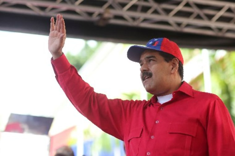 Venezuela's President Nicolas Maduro waves as he attends a rally against imperialism at Miraflores Palace in Caracas, Venezuela September 19, 2017.