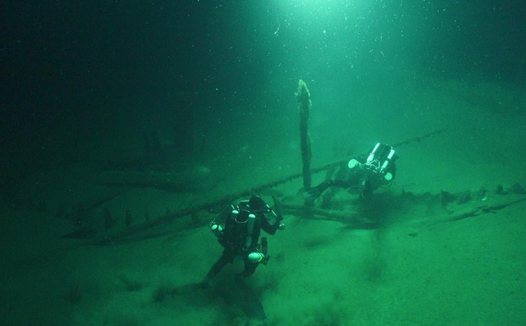 Image: The Roman Galley lies partially buried with masts still standing, rudders and tillers attached and ropes still intact.