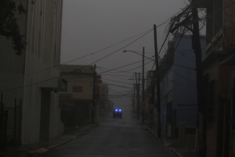 Image: A police car patrols a road as Hurricane Maria hits Puerto Rico in Fajardo
