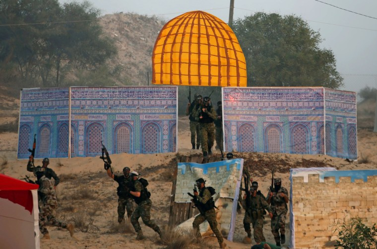 Image: Palestinian militants of the al-Nasser Saladin Brigades take part in a drill as a model depicting the Dome of the Rock is seen, in Khan Younis in the southern Gaza Strip