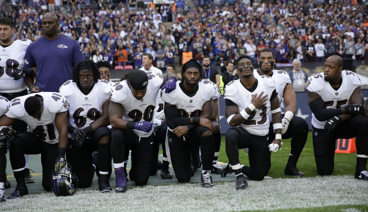 Baltimore Ravens players kneel during the playing of the U.S. national anthem before their game against the Jacksonville Jaguars at Wembley Stadium in London on Sunday.